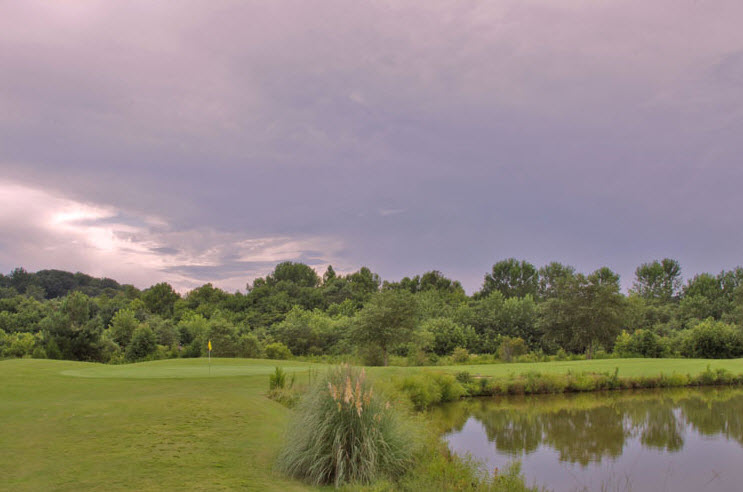 Image: Ominous clouds over fairway and lake at Salem Glen Country Club | Clemmons NC
