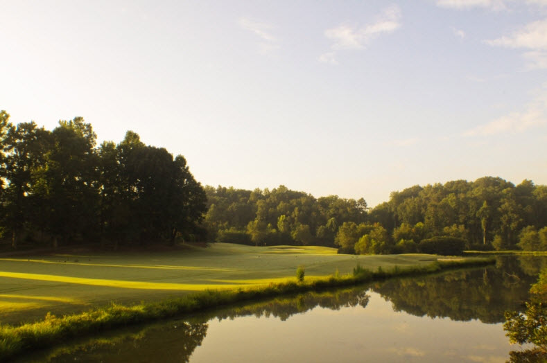 Image: Narrow fairway with water in foreground at Salem Glen Country Club | Clemmons NC